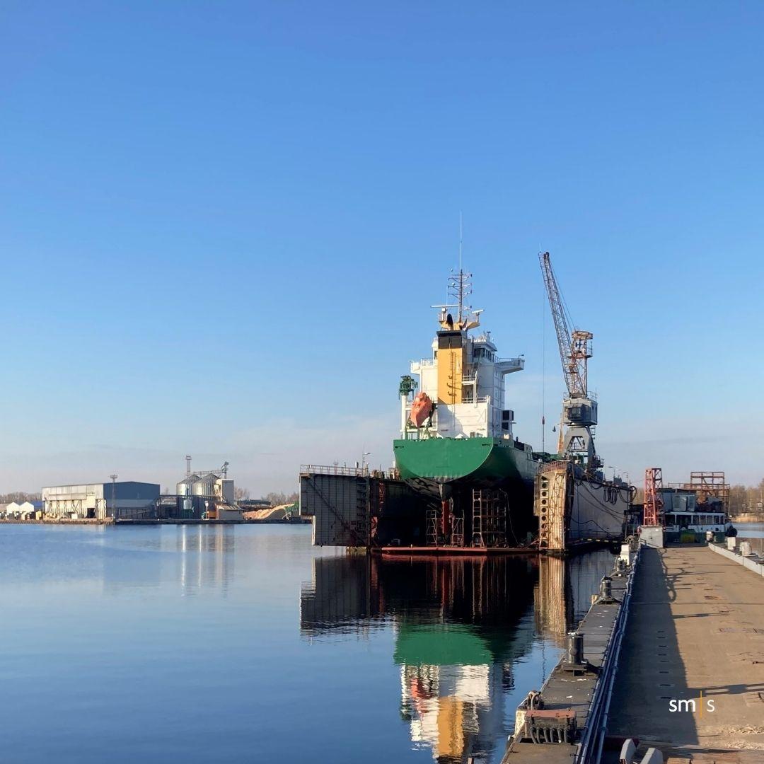 vessel sitting on floating dock