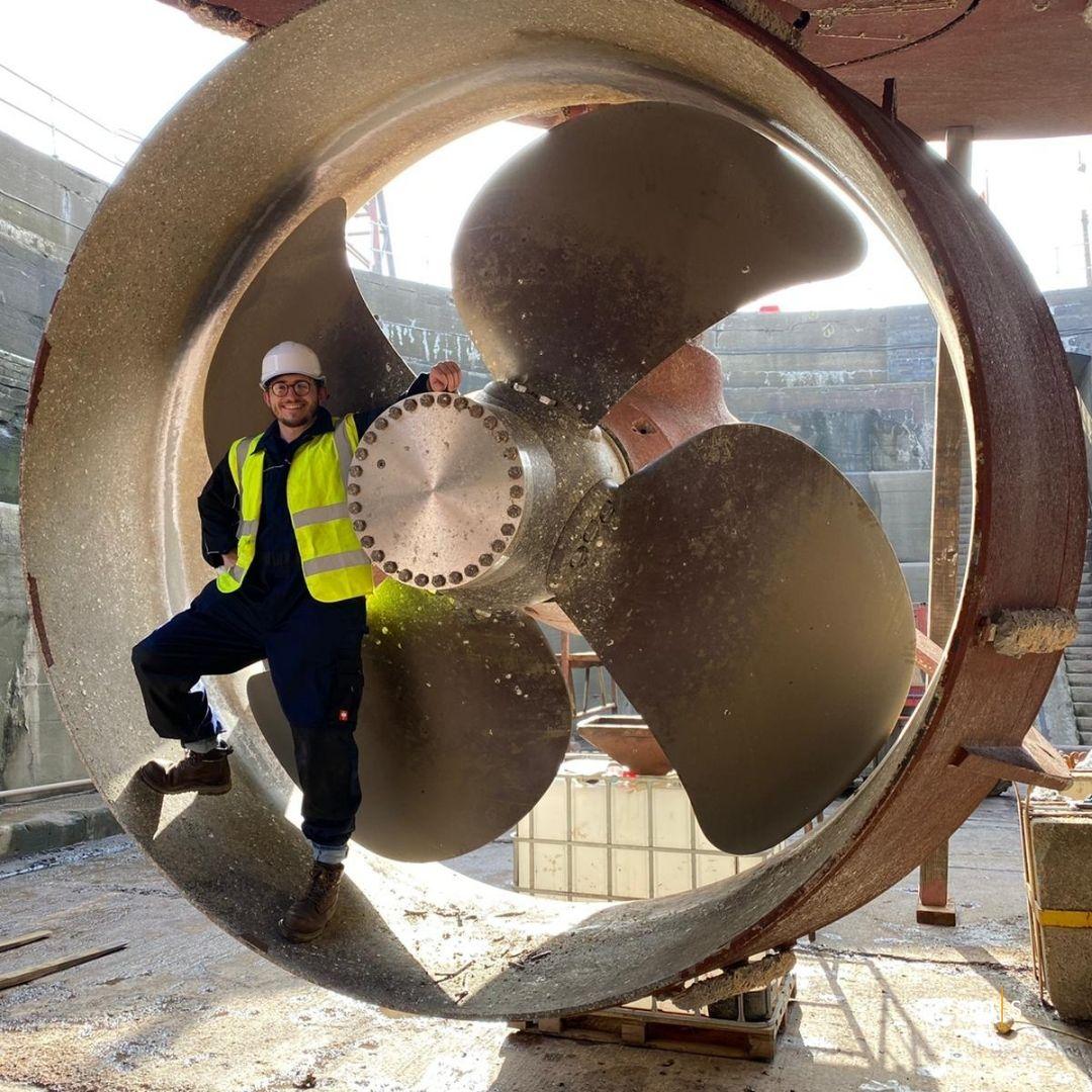 engineer standing inside a vessel thruster